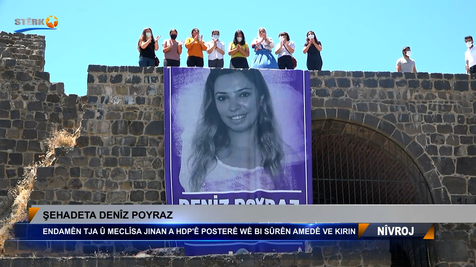 Endamên TJA û meclîsa jinan a HDP'ê posterê Denîz Poyraz bi sûrên Amedê ve kirin